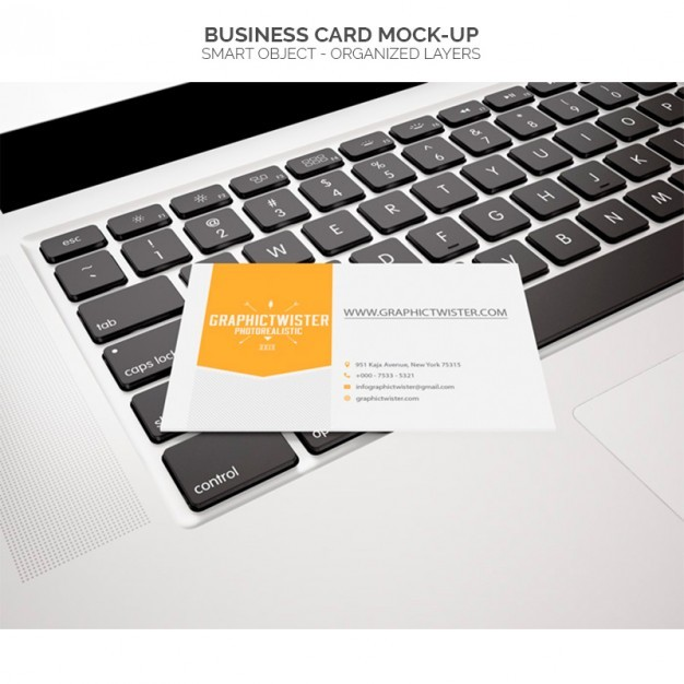 Business card mock-up on laptop