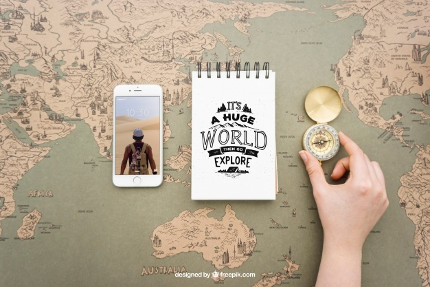 Smartphone, notepad and compass