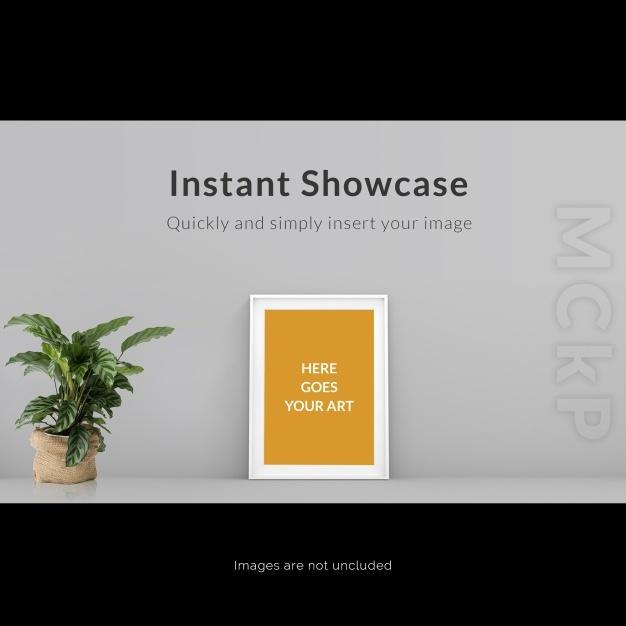 Frame on grey wall with plant mock u
