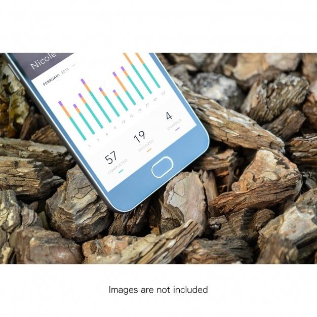Half mobile phone screen on stones mock up